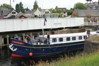 36 boat passing bridge