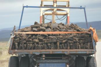 09 peat being moved after drying