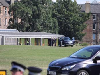 16 car arriving at helicopter