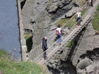 34 going across suspension rope bridge