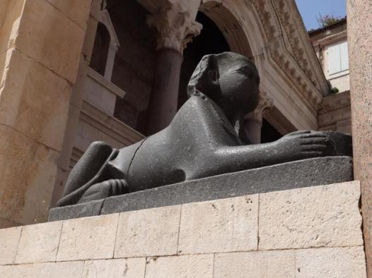 22 sphinx at the foot of the bell tower
